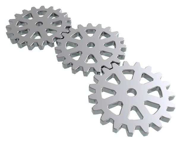 Three gray gears connected as a chain.