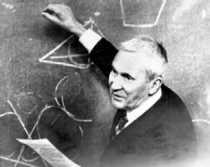 Andrey Kolmogorov explaining something on a blackboard.