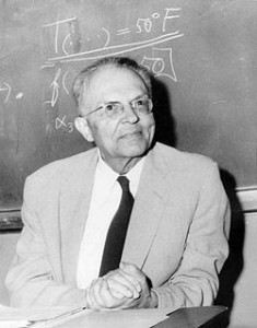 A picture of Rudolf Carnap in front of a blackboard.