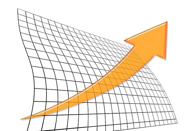 An orange arrow on a grid background representing an upward trend