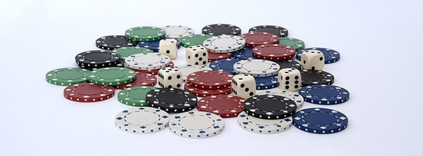 A pile of poker chips and a few dice