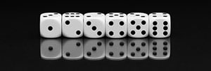 A photo of six white standard dice